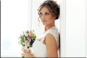 Wedding. Attractive bride with bouquet
